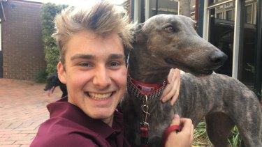 Student Chris Brown with Frieda the greyhound on Sunday.