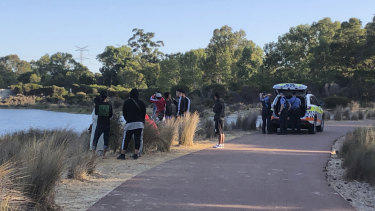 Police divers are on the way to Champion Lakes after a young man went missing during a swim.