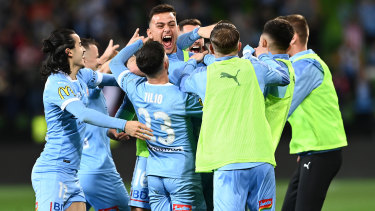 Scott Galloway of Melbourne City celebrates with his teammates after scoring their third goal during the A-League grand final.