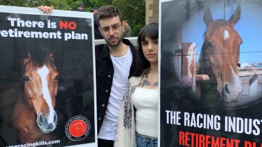 Adam and Lauren Trani protested against animal cruelty at the Melbourne Cup Parade.