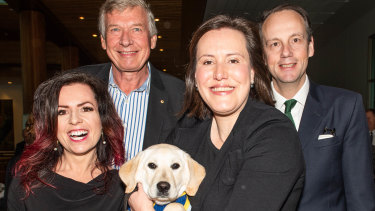 Nicole Pedersen-McKinnon (left) at Parliament for the launch of the 2018 National Financial Capability Strategy, with National Financial Literacy Board chairman Paul Citheroe, former financial services minister Kelly O'Dwyer (with a seeing eye dog in training that was shadowing her around Parliament) and ASIC chairman James Shipton.