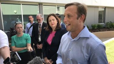 Queensland Health Minister Steven Miles (front, right) speaks to media alongside Premier Annastacia Palaszczuk.