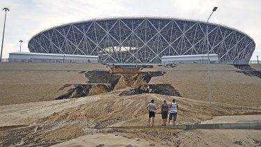 A huge crack has formed in an embankment outside Volgograd Arena after heavy rain triggered a landslide.