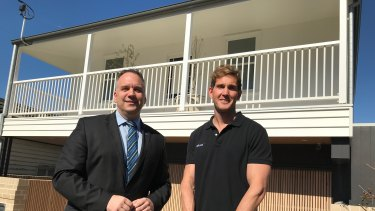Andrew Gray (right) with Matthew Bourke outside his renovated Paddington Queenslander.