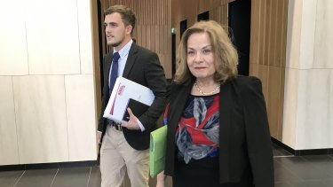 Prince Charles Hospital nurse Marg Gilbert leaves the Industrial Commission with Jack McGuire of the Queensland Nurses' Professional Association.
