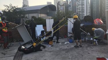 Protesters use a catapult to hurl rocks police laying siege to Hong Kong Polytechnic University.