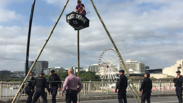 The woman climbed a 10-metre structure on Victoria Bridge, blocking peak-hour traffic.