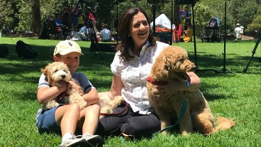 Premier Annastacia Palaszczuk holds Winton, while her nephew Harry holds Oakey after a news conference in Sinnamon Park.