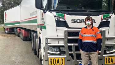 Road-train driver Rick McQuade returns to his truck on the South Australia-Victoria border after submitting to another of his weekly COVID-19 tests.
