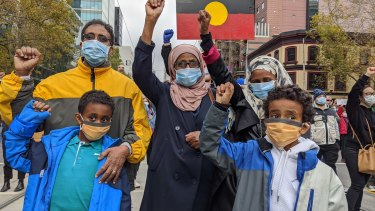 Ezi Osman at Melbourne's Black Lives Matter protest with her family.