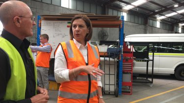 LNP leader Deb Frecklington has spent most of the campaign in various sheds wearing high-vis.
