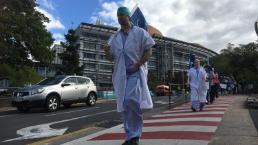 Workers strike outside Brisbane's Princess Alexandra Hospital over the state government's planned public service wage freeze.