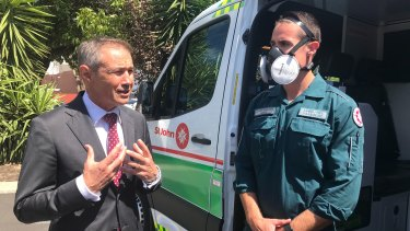WA Health Minister Roger Cook with a St John paramedic wearing one of the new masks