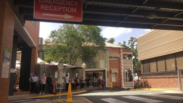Patients line up at the Ipswich Hospital COVID-19 testing clinic on Saturday.