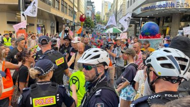 Police monitor the Extinction Rebellion protest in the Brisbane inner city last week.