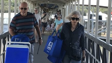 Moreton Bay island residents return from shopping trips to the mainland.