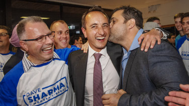 Liberal's Dave Sharma celebrates with guests at Easts Rugby Club in Rose Bay.