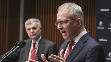 NBN Co CEO Stephen Rue and Minister for Communications, Cyber Safety and the Arts Paul Fletcher during a press conference at Parliament House in Canberra on  Wednesday.
