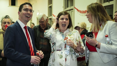 Newly elected Perth MP Patrick Gorman, his wife Jess, and Shadow Health Minister Catherine King watch the count on Saturday night.