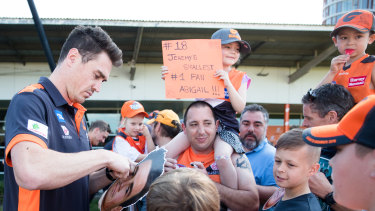 Jeremy Cameron signs autographs for fans at the Giants' family fun day on Sunday.