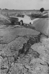 """Huge mound is pushed up and deep fissures open closing the main road between York and Meckering. The hump in the road is 6ft. high."" October 15, 1968."