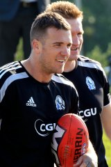 Dane Swan and Nathan Buckley at Pies training in 2012.