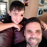 Kerry Rooney, who was stabbed to death outside his Newmarket home, with his son.