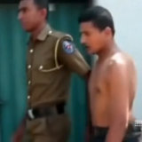 A suspect being arrested in Colombo.