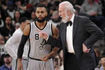 Mills with his mentor and San Antonio Spurs coach Gregg Popovich.