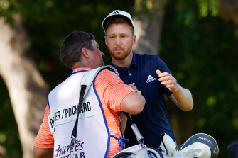 Daniel Berger celebrated with his caddie after winning the Charles Schwab Challenge.