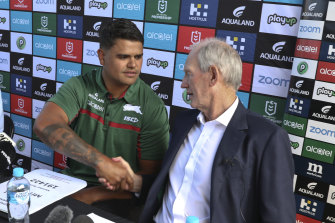 New recruit Latrell Mitchell shakes hands with Souths coach Wayne Bennett on Monday.