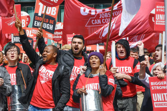 Members from union United Voice marching for improved Crown Casino workers' wages and conditions.