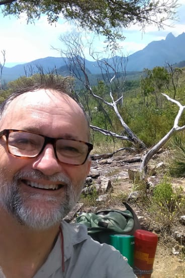 The quick actions of emergency department doctor John Hadok helped save the life of a Tasmanian tourist bitten by a shark in the Whitsunday Islands.