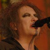 The Cure's Robert Smith on stage in Hyde Park, London, for the band's anniversary concert in 2018.