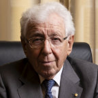 Sir Frank Lowy fled on a 'rickety old ship' designed for 150 people, but carrying 700
