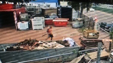"CCTV from Jolly Street, Woolner, Darwin show images of a man believed to be accused gunman Ben Hoffmann after he was allegedly stabbed by security guard Rob ""Kiwi Bob"" Courtney."