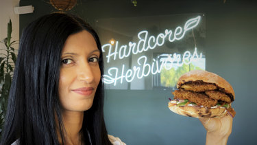Shama Sukul Lee, the founder of Sunfed, with a burger made using her chicken free chicken product.