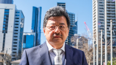 One of the fresh photos taken of elusive TPG executive chairman David Teoh as he arrived at court in Melbourne on Wednesday.
