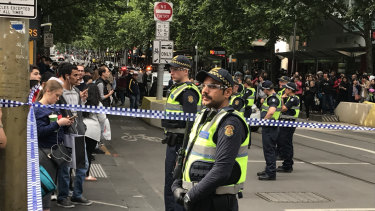 Police block off Bourke Street.