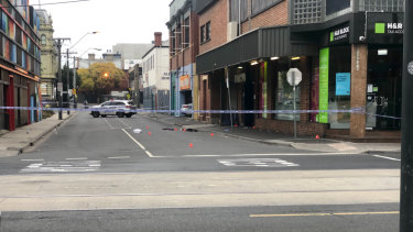 Detectives at the scene of a drive-by shooting outside the Love Machine nightclub in Prahran.