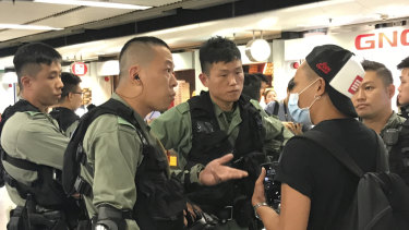 Gary is stopped by riot police at Admiralty MTR.