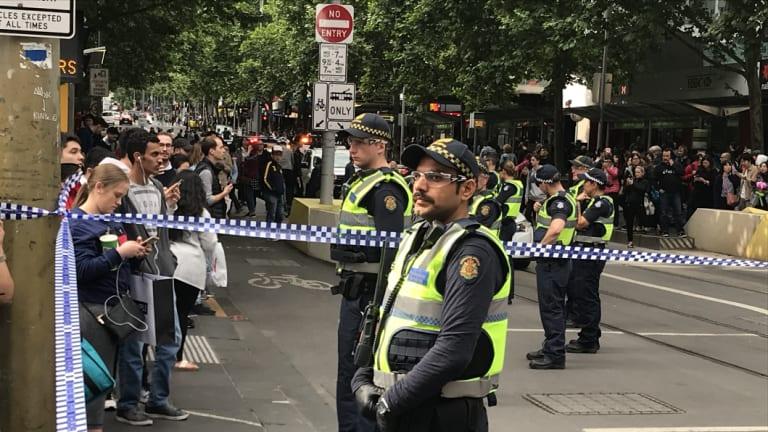 Police block off Bourke Street.