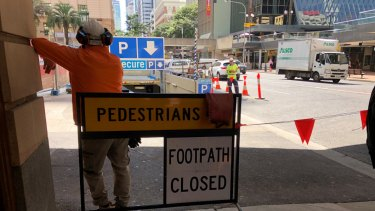 Footpath closed sign on Adelaide Street near Anzac Square.