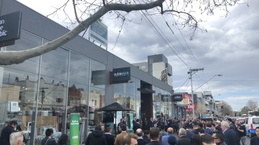 The crowd at the auction of the Adairs building on Bridge Road, Richmond on Thursday.