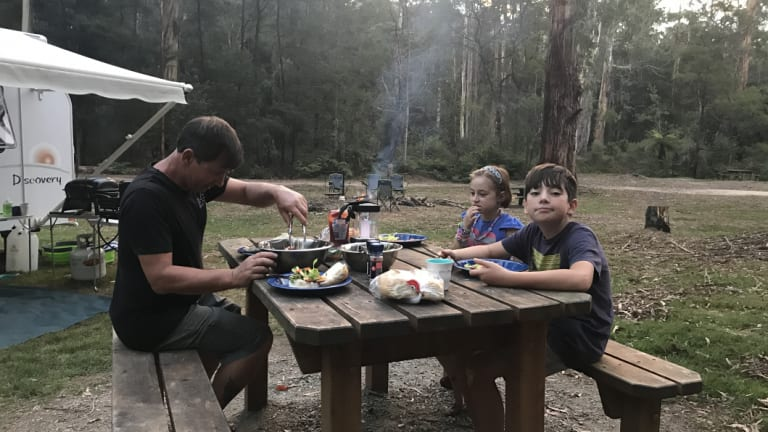 Marcus Andrews with his kids Quinn, 11, and Asha, 6, enjoying the relaxed lifestyle in the Gippsland Lakes region.