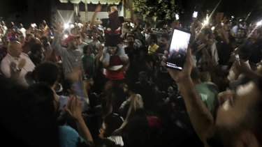 Protesters chant slogans against the regime in Cairo.