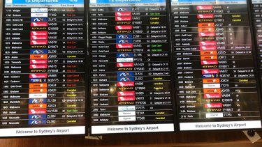 The departures board at T2 Sydney Airport on Friday night.