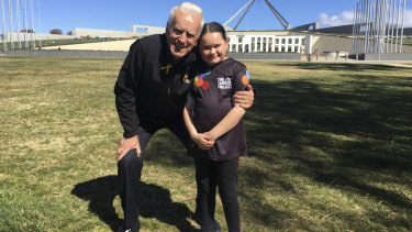 Today, Audrey (pictured with The Kids' Cancer Project founder Col Reynolds) is a healthy young girl heading to high school next year.