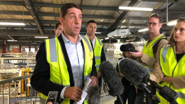 State Development Minister Cameron Dick announces the 15-year licence extension at the XXXX brewery.