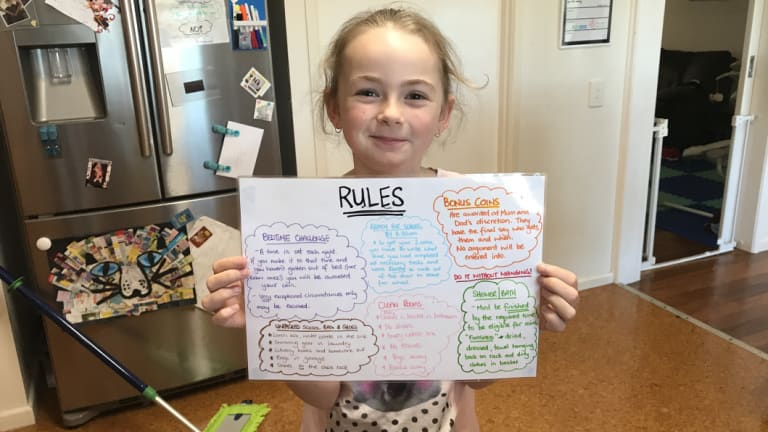 Mackenna holding up the house rules.